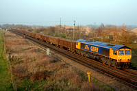 66706'Nene Valley' at Catholme  near Burton on Trent heading towards Wichnor Junction on 14.3.12 with 6Z97 1445 Beeston - Cardiff Tidal Sdgs loaded scrap train in low sun