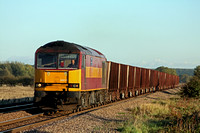 60019 at Worlaby Carrs  on 20.10.10 with 6T26 1445 Immingham- Santon loaded iron ore wagons