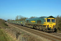 66604 at Whissendine between Melton Mowbray and Oakham on 1.2.12 with 6Z56 1000 Bescot Down Sdgs - Chesterton Junction loaded FHH aggregate wagons