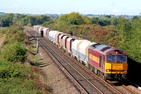 60021 in EWS red and gold livery at Willington heading towards Burton Upon Trent on 18.9.07 with 6M11 0830 Washwood Heath -  Peak Forest empty RMC & Cemex  hoppers