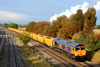 66752 'The Hoosier State' at Kegworth, MML on 7.10.14 with 6M23 1257 Doncaster Up Decoy - Mountsorell Sdgs empty IOA yellow Network Rail wagons. The white steam from Ratcliffe P.S. contrasts with the