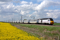 East Coast HST 43302 and 43367 at Frinkley Lane, Marston heading towards Grantham on 8.5.12 with 1615 Leeds - London Kings Cross service alongside an oilseed rapefield in full bloom