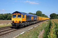 66701 in original GBRf livery powers through East Goscote heading towards Syston East Junction on 8.9.14 with 6M60  1112 Whitemoor Yard L.D.C Gbrf - Mountsorell Gbrf Sdgs empty yellow Network Rail IOA