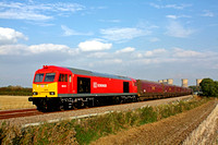 60074 now repainted in DB Schenker red livery is seen at Willington Fields heading towards Uttoxeter on 22.9.14 with 6F58 1530 Ratcliffe P.S. - Liverpool Bulk Terminal empty coal hoppers