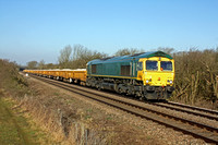 Ex Freightliner now GBRf 66738 at Whissendine between Melton Mowbray and Oakham on 1.2.12 with 6L24 1024 Mountsorrel - Whitemoor loaded JNA ballast wagons