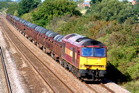 60031 at Cossington, MML heading towards Syston East Junction on 26.9.06 with 6M96 0550  Margam - Corby BSC loaded coil wagons