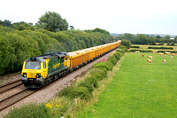 70010 is seen at rural Barrow Upon Trent heading towards Stenson Junction on 20.7.11 with 6C64  1348 Mountsorrel - Carlisle loaded Network Rail yellow IOA wagons