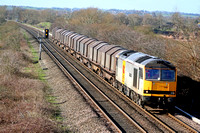 EWS 60055 in two tone grey livery at Willington heading towards Burton Upon Trent on 6.3.07 with 6E08 0718 Wolverhampton Steel Terminal - Doncaster Belmont loaded steel wagons