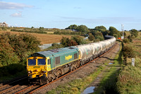 66604 at Wistow, MML heading towards Leicester on 16.9.10 with 6M92 West Thurrock - Earles Sdgs empty La Farge 4 wheeled cement hoppers in beautiful evening light