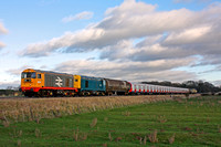 20227 & 20142 tnt 20901 & 20905 at Rearsby heading towards Syston East Junction on 11.1.12 with 7X09 1142 Old Dalby - Amersham with S Stock and tank barriers