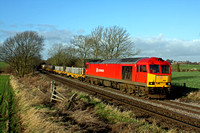 60011 in DB Schenker livery at Chellaston heading towards Castle Donington on 8.1.15 with 6D44 1109 Bescot Up Engineers Sdgs - Toton North Yard departmental loaded with concrete sleepers