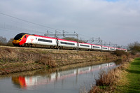 Virgin Pendolino 390017  alongside the Oxford Canal at Ansty heading towards Nuneaton on 2.3.11. with 1407 London Euston - Liverpool Lime Street service