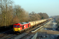 DB Cargo 60007 'The Spirit of Tom Kendel' in DB Schenker livery passes a cold and frosty Stenson Junction on 28.12.16 with 6M57 0715 Lindsey Oil Refinery - Kingsbury Oil Sdgs loaded oil tanks