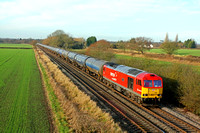 DB Cargo 60007 'The Spirit of Tom Kendel' in DB Schenker livery  passes Barrow Upon Trent on 22.12.16 with 6E54 1035 Kingsbury Oil Sdgs - Humber Oil Refinery empty blue bogie tanks