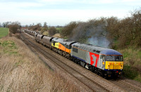 Europhoenix 56096 with dead 66848 departs Elford loop 19.3.14 with 4V30 0825 Ratcliffe  Pst - Avonmouth  empty coal hoppers. The 56 had rescued the train and terminated the working at Landor St Jn
