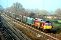 60045 at Meadow Lane Loughborough on  21.12.06 with 6Z88 Drax - Hotchley Hill loaded Gypsum containers running via Humberstone Road, Leicester