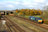 DRS 66430 on hire to GBRf is seen from Moorbridge lane, Stapleford  on 18.11.14 with 6M73 1052 Doncaster Up Decoy -Toton North Yard departmental in lovely late autumn colours passing beneath the M1