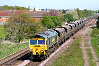 66561 at Branston, near Burton upon Trent on 22.4.09 with 4G01 0955 Hunslet Yard -Tyseley FHH hoppers for repair