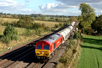 DB Schenker livery  66118 enters the loop at Kilby Bridge near Wigston on 23.10.13 with 6F93 1103 Churchyard Sdgs, St Pancras -  Ketton Ward Sdg empty castle cement tanks in lovely autumn light