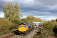 GBRf 59003 'Yeoman Highlander' passes  an autumnal Willington heading towards Burton Upon Trent on 4.11.16 with 6V09 1051 Tinsley Yard - Coton Hill Tc empty hoppers