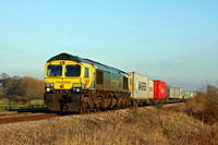 Freightliner Class 66 No 66420 in Powerhaul livery passes Wyfordby  near Melton Mowbray on 28.12.16 with diverted 4M88 0932 Felixstowe North F.L.T. - Crewe Bas Hall S.S.N. liner