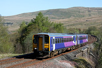 A pair of Northern Rail Class 153s No's 153359 & 153331 cross Dent Head Viaduct, Settle - Carlisle line on 3.5.17 with 2H85 0853 Carlisle - Leeds service