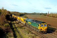 Freightliner 66603 is pushing frantically at the rear of diverted  6Y07 1030 Bedford South Jn. to Stapleford & S C C E Sdg HOBC train  on 13.11.16 climbing  Bagworth Incline towards Coalville