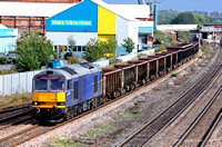 Mainline blue EWS 60011 at Loughborough on 1.9.09 with 6M47 1218 Norwich - Peak Forest  empty  stone MEA Box Wagons