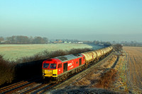 DB Cargo 60007 'The Spirit of Tom Kendel' in DB Schenker livery passes a frosty Lockington near Castle Donington  on 28.12.16 with 6M57 0715 Lindsey Oil Refinery - Kingsbury Oil Sdgs loaded oil tanks