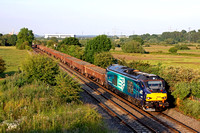 Just before 8pm in late evening sun DRS 68004 charges through Weston on Trent heading towards Stenson Junction on 23.6.15  with 6Z97 1933 Toton North Yard - Crewe Bas Hall S.S.M. departmental