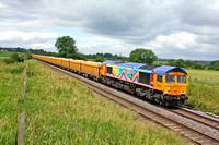 Rainbow liveried 66720 at Copleys Brook near Melton Mowbray on 11.7.12 with 6L24 1027 Mountsorrel - Whitemoor empty Network Rail yellow IOA's