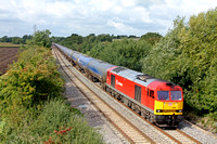 60063 in DB Schenker livery at Arleston heading towards Castle Donington on 18.9.13 with 6E54 1040 Kingsbury Oil Sdgs - Humber Oil Refinery empty blue bogie tanks