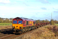 DB Cargo 66140 passes  Narborough heading towards Hinckley on 3.2.17 with 6V92  1022 Corby B.S.C. - Margam T.C. empty steel coil wagons