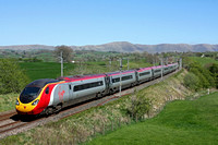 Virgin Trains  Pendolino 390153 races past Docker, WCML south of Tebay on 3.5.17 with 9M56 1252 Edinburgh - London Euston service