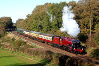 LMS Stanier Class 8F No 48624 in red livery at Kinchley Lane on 10.11.13 with 1315 'The Elizabethan' Loughborough - Leicester North GCR diner service in lovely autumn light