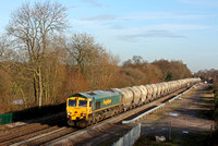 Freightliner 66613 passes Stenson Junction on 22.12.16 with 6G65  0919 Hope (Earles Sidings) - Walsall Freight Terminal loaded 4 wheeled cement tanks
