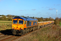 66728 'Institute of Railway Operators' nears Narborough Foot Crossing heading towards Hinckley on 5.11.14 with 6G16 1124 Cliffe Hill Stud Farm Gbrf -Bescot Up Engineers Sdgs loaded low JNA ballast wag