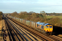 GBRf 66766 passes Cossington, MML heading towards Syston East Junction on 23.12.15 with 4E83 1315 Hotchley Hill (East Leake) - Doncaster Robert Rds Shed empty gypsum containers
