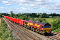 DB Cargo 66099 crosses from fast to slowline at Trowell Junction on the Erewash Valley Line on 5.7.16 with 6Z69 1350 Heck Plasmor P S - Dowlow Briggs Sdgs via Toton North Yard empty red new MMA wagons