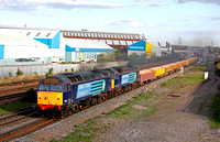 57011 & 57004 both working hard thunder through Loughborough on 14.4.14 with 6C89 1656 Mountsorrel Sdgs - Carlisle N.Y. loaded ballast box wagons some 78 mins late due to 66304 failing on the inward w