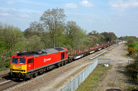 60017 in DB Schenker livery rumbles paast Stenson Junction on 20.4.15 with 6X01 1017 Scunthorpe Trent T.C. - Eastleigh East Yard welded rail train