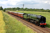 British Railways Standard Class 9F 2-10-0 No 92214 now re-painted in Brunswick green and lined out is seen at Woodthorpe on 21.6.14 with 1630 Loughborough - Leicester North service at the GCR Model Ev