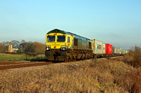 Freightliner 66420 in Powerhaul livery passes Wyfordby Church near Melton Mowbray on 28.12.16 with diverted 4M88 0932 Felixstowe North F.L.T. - Crewe Bas Hall S.S.N. liner