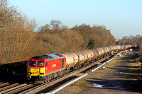 DB Cargo 60059 'Swinden Dalesman' in DB Schenker livery passes Stenson Junction on 22.12.16 with 6M57  0715 Lindsey Oil Refinery - Kingsbury Oil Sdgs loaded bogie oil tanks