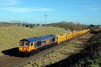 66769 one of GBRf latest newbies is seen on the outskirts of Melton Mowbray on 17.2.15 with 6M60  1112 Whitemoor Yard L.D.C - Mountsorell Sdgs empty Network Rail yellow IOA wagons