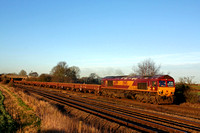 DB Cargo 66199 passes Thurmaston, MML after a signal check at Syston South Junction heading towards Leicester on 4.2.17 with 6B01 1439½ Toton North Yard - Hendon empty MOA wagons in low sun