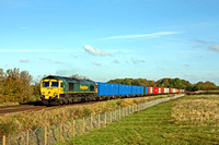Freightliner 66565 powers past Rearsby heading towards Syston East Junction on 11.11.16 in charge of 4M81 0801 Felixstowe North F.L.T. - Crewe Bas Hall S.S.N. liner with a colourful array of container