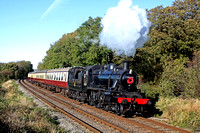LMS Ivatt Class 2 No 46521 at Kinchley Lane on 10.11.13 with 1315 Loughborough - Leicester North GCR service adorned with a wreath of poppies marking Remembrance Sunday in lovely autumn light